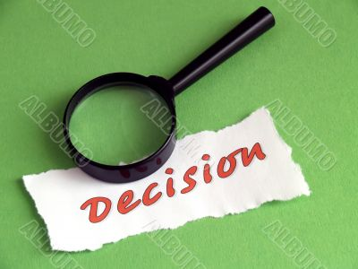 Decision, magnifier on green