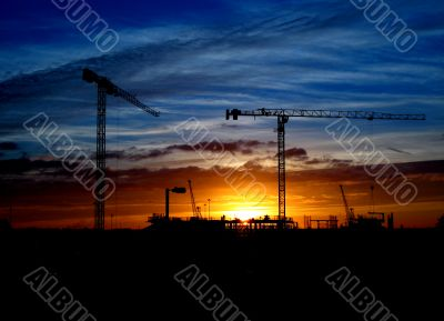 Cranes and construction site silhouette