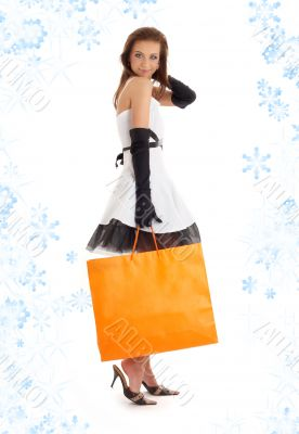 lady with orange shopping bag and snowflakes #3