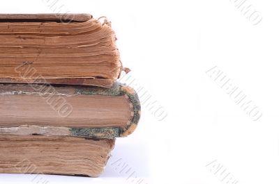 Three ancient vintage books.