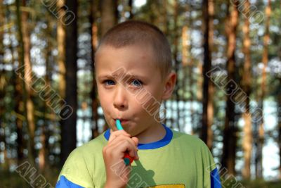 boy is brushing his teeth