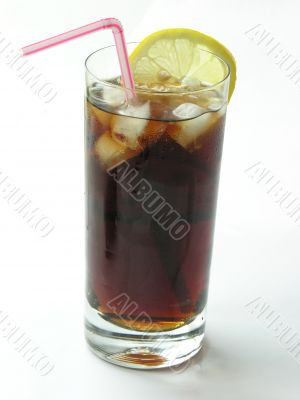 brown cooling drink with ice and lemon slices