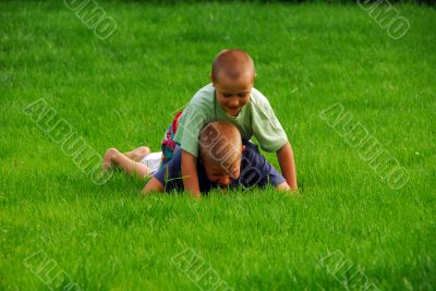boys play on the grass