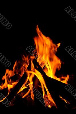An intense log burning fire with red hot flames