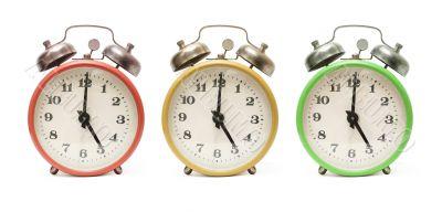 3 colored alarm clocks isolated