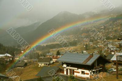 Rainbow across alpine village