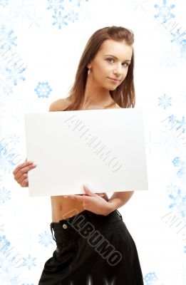 girl holding blank sign board with snowflakes