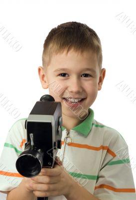 The boy with a retro movie camera