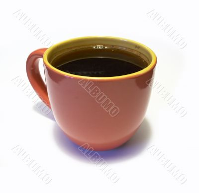 glazed pottery cup of coffee