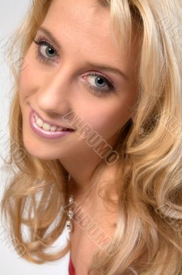 Studio portrait of a long blond girl flirting