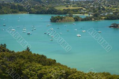 Idyllic blue lagoon with yachts