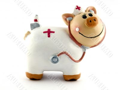 Souvenir - a toy a pig on a white background