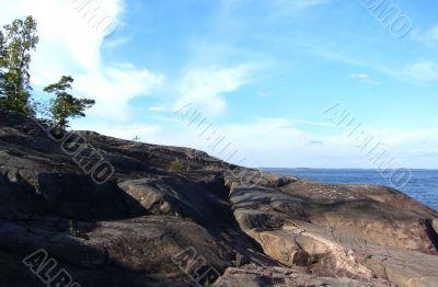summer rock coastline on Ladoga lake