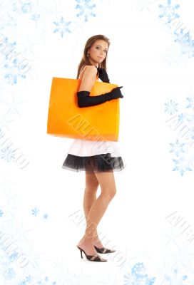 lady with orange shopping bag and snowflakes