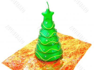 new-year candle in form the decorated fir-tree on a white backgr