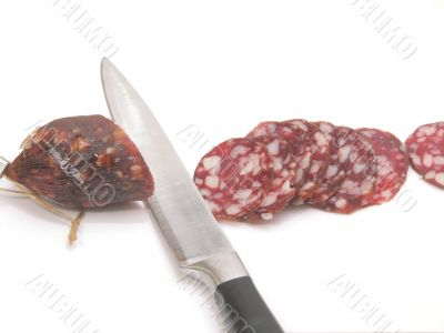 summer sausage and  kitchen knife