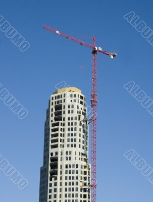 Red Crane on Construction Tower