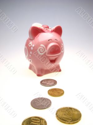 piggy bank and many coins