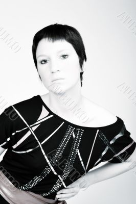Studio portrait of a young woman with short hair in a fashion po
