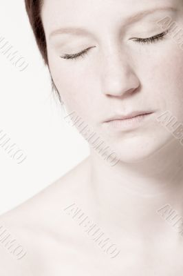 Studio portrait of a young woman with short hair relaxing