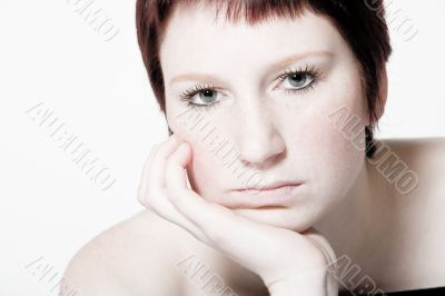 Studio portrait of a bored young woman with short hair