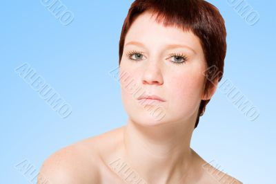 Studio portrait of an uptight young woman with short hair
