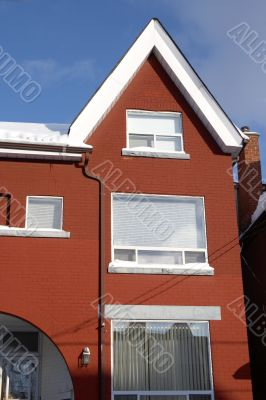 Snowed red-bricked townhouse in downtown Toronto
