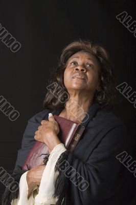Woman Holding Bible White Sleeves