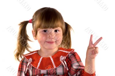 Little girl making victory sign
