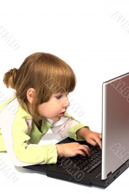 Child typing message from laptop