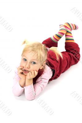 Pensive girl lying on the floor