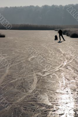 People skating on natural ice