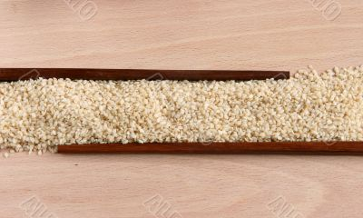 Sesame corn on a wooden plate with sticks