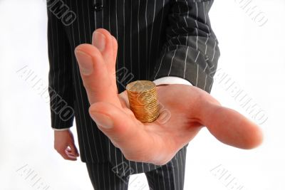 businessman holds  pile of coins