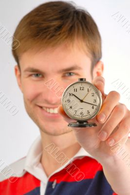 guy with an alarm clock in hands