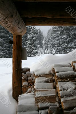 Wood pile under mountain hut