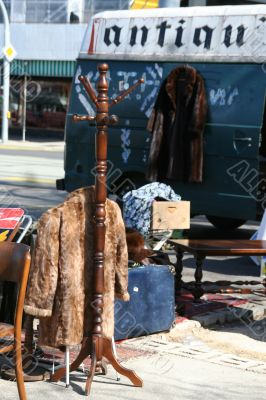 Fur coats and antique dealer`s van