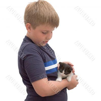 boy cuddling his pet kitten