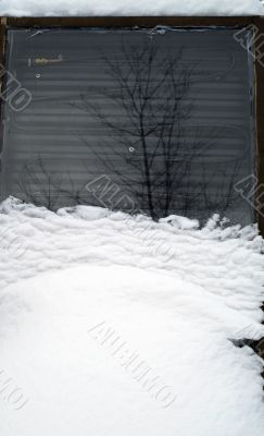 snow covered solar hot water heater