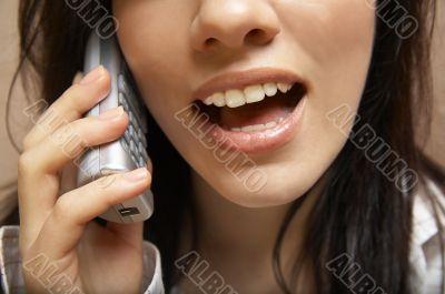 young woman is speaking on cell phone