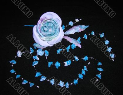 artificial rose and blue bellflowers