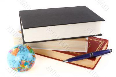 Books, pen and globe