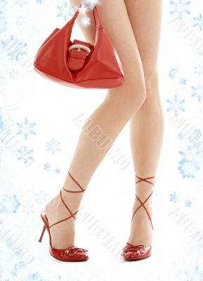 high heels and red purse with snowflakes