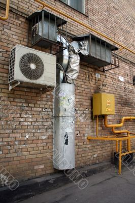air conditioner on the brick wall with airshaft