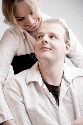 Portrait of a young loving couple looking