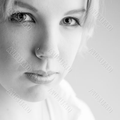 Portrait of a confident blond curly woman