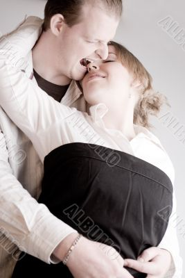 Portrait of a young biting loving couple