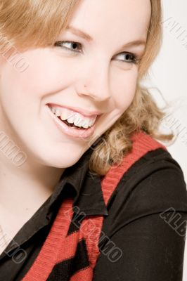 Portrait of a laughing blond curly woman