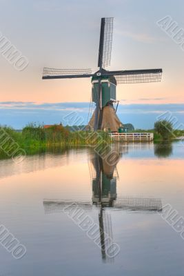 Dutch windmill in quiet waters