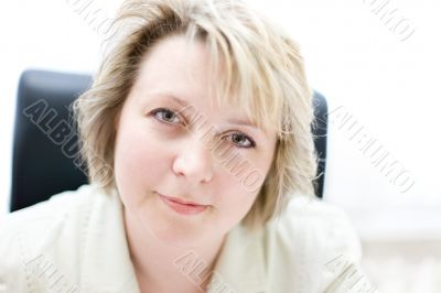 Mid-life business woman in office look at camera